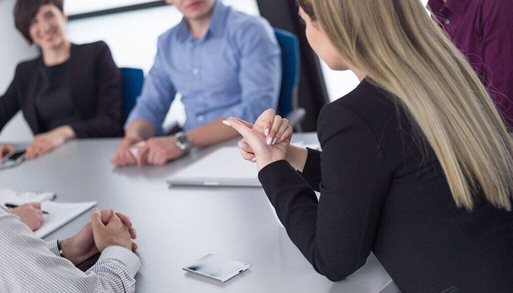 business-team-at-a-meeting-at-modern-office-buildi-67KQ58S